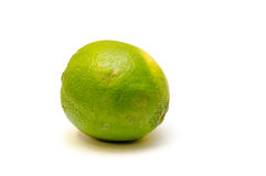Green Lime  on White. A green lime  on a white background with shadow Royalty Free Stock Photos