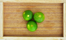 Green lime in the wood box Royalty Free Stock Photos