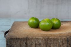 Green lime on wood board. Green lime on wooden board stock photos