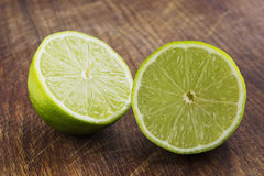 The green lime. On a wooden table royalty free stock photography