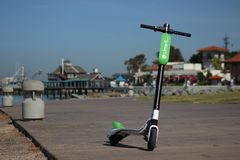 A green Limebike Lime-S electric scooter in downtown San Diego. A green Limebike Lime-S electric scooter is parked in San Diego`s Embarcadero Marina Park, ready stock photo