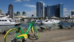 A green Limebike is ready for the next user in downtown San Diego royalty free stock image