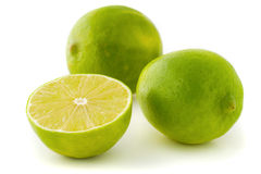 Green limes. Two whole limes and a half lime isolated on white background Royalty Free Stock Photography