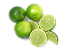 Green limes. Ripe limes on white background Stock Image