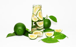 Green limes. In a bottle with green leaves isolated stock images