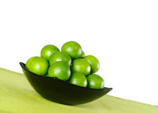 Green Limes in Black Bowl Royalty Free Stock Photo