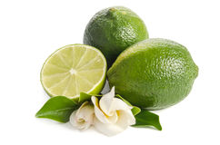 Green limes with half of juicy lime and beautifull flower Royalty Free Stock Photography