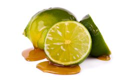 Green limes with honey Stock Image