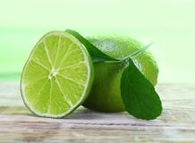 Green limes with leaves Royalty Free Stock Images