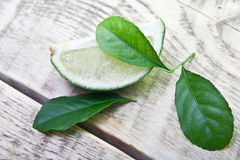 Green limes with leaves Stock Photos