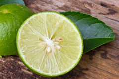Green limes with leaves Royalty Free Stock Photos