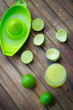 Green limes with lime juice in the glass Stock Image