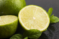 Green limes with mint and water drops Royalty Free Stock Photo