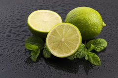 Green limes with mint and water drops Stock Photography