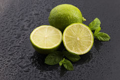 Green limes with mint and water drops Stock Image