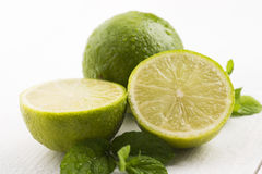 Green limes with mint and water drops Stock Photo