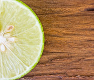 Green limes on wooden Stock Photography