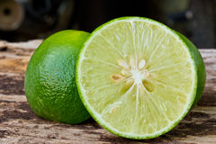 Green limes on wooden Stock Photos