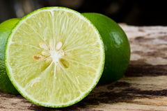 Green limes on wooden Royalty Free Stock Images