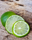 Green limes on wooden Royalty Free Stock Image