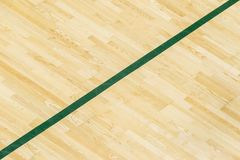 Green line on the gymnasium floor for assign sports court. Badminton, Futsal, Volleyball and Basketball court royalty free stock image