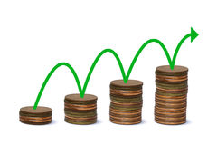 Green line on stack of gold coins graph Stock Photo