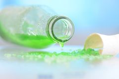 Green liquid in a bottle. Green liquid in a glass bottle still life Royalty Free Stock Photos