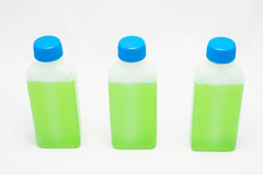 Green liquid in bottles Royalty Free Stock Images