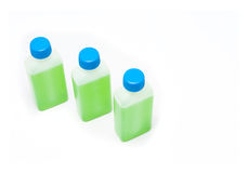Green liquid in bottles Stock Images