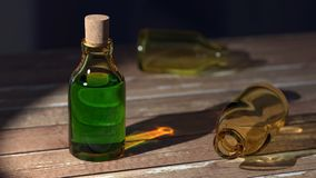 Green Liquid on Clear Glass Bottle With Cork Stock Photo