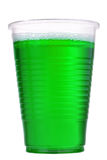 Green liquid in the plastic glass Royalty Free Stock Photography