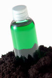 Green liquid and soil Royalty Free Stock Images