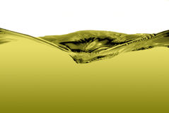 Green liquid wave. Isolated on a white background Stock Photos