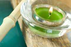Green lit candles and bamboo Royalty Free Stock Photo