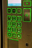 Green lit keypad for a door entry system. A door entry system keypad for a code to be entered to gain entry Royalty Free Stock Photography