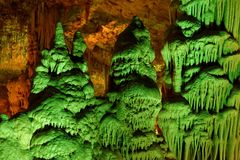 Green-lit stalagmite shapes in Soreq Cave, Israel. Strange green-lit stalagmite shapes in Soreq Cave, Israel Stock Image