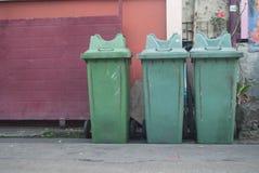 Green litter bin public. Near wall Stock Images