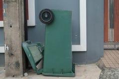 Green litter bin public. Near wall Royalty Free Stock Photos