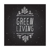 Green living - product label on chalkboard Royalty Free Stock Photo