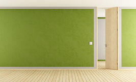 Green living room with open door Stock Photo