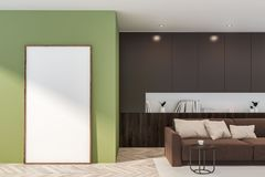 Green living room with sofa and poster stock image