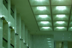 Green Lobby Lights. Lights and pillars within a lobby of a building Royalty Free Stock Images
