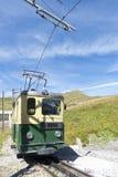 Green locomotive - Kleine Scheidegg, Switzerland Royalty Free Stock Images