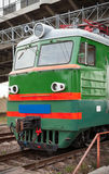 Green locomotive with red stripes Stock Photography