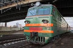 Green locomotive with red stripes Stock Image