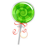 Green Lollipop with Wrapper and Tag Stock Photo
