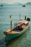 A green long tail boat Royalty Free Stock Photo