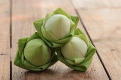 Green lotus. Three green lotus on wood background Stock Images