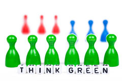 Green ludo figures behind think green letters Stock Photos