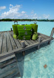 Green luggage at the pier Royalty Free Stock Photo